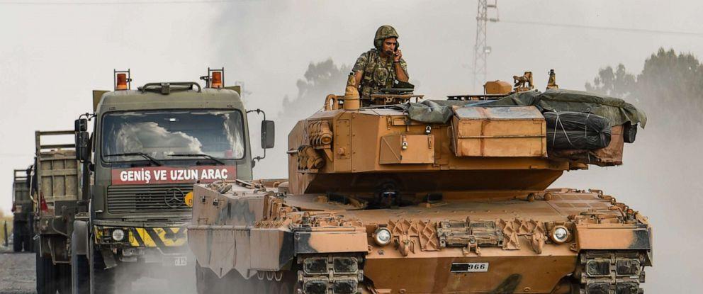 PHOTO: A Turkish army tank moves towards the Syrian border on October 18, 2019 in Ceylanpinar, Turkey.