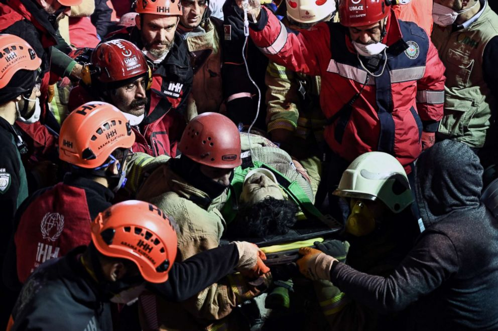 PHOTO: Rescuers carry an injured woman on a stretcher from the site of a collapsed building in Turkey, Feb. 7, 2019.