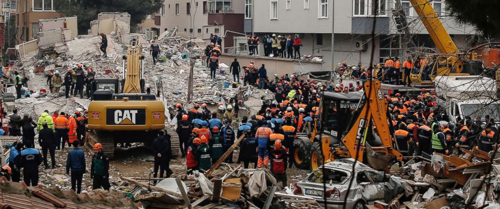 PHOTO: Rescue workers try to remove rubble from an eight-story building which collapsed a day earlier in Istanbul, Feb. 7, 2019.