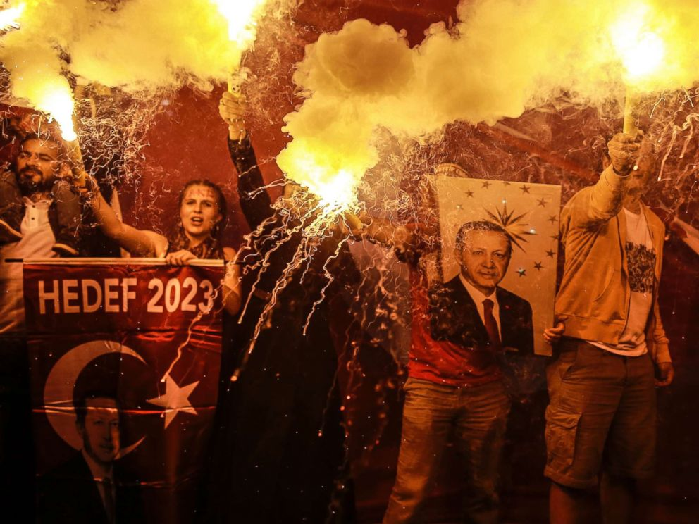PHOTO: Supporters of Turkeys President and ruling Justice and Development Party, or AKP, leader Recep Tayyip Erdogan light flares during celebrations outside the party headquarters in Istanbul, June 24, 2018.