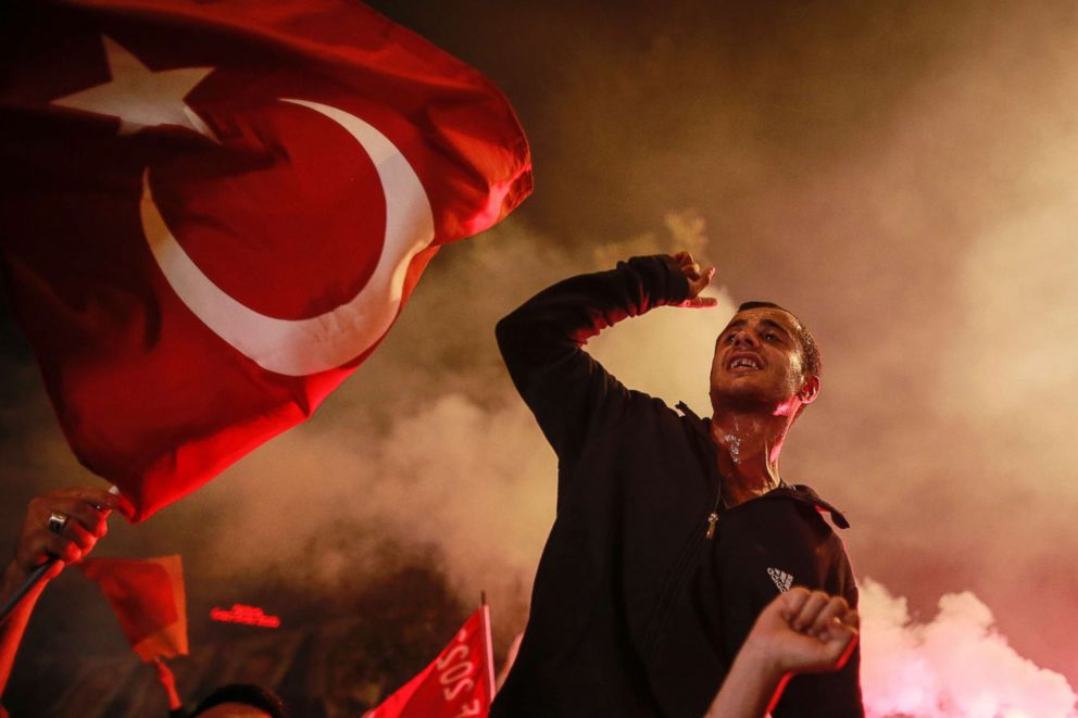 PHOTO: A supporter of Turkeys President and ruling Justice and Development Party, or AKP, leader Recep Tayyip Erdogan, chants slogans during celebrations outside the party headquarters in Istanbul, June 24, 2018.