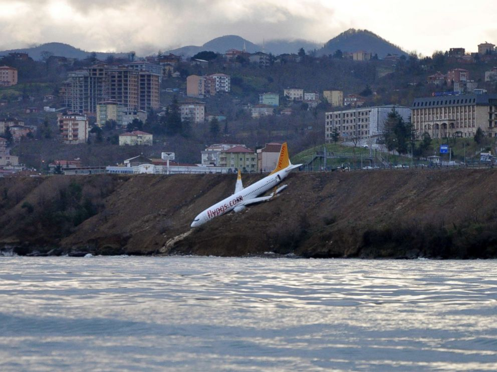 PHOTO: A Boeing 737-800 of Turkeys Pegasus Airlines is pictured after skidding off the runway downhill towards the sea at the airport in Trabzon, Turkey, Jan. 14, 2018.