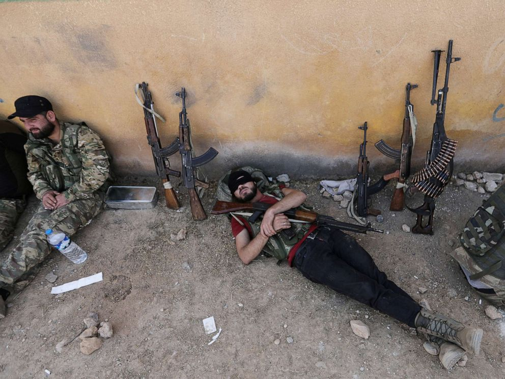 PHOTO: A Turkey-backed Syrian rebel fighter takes a rest near the border town of Tal Abyad, Syria, Oct. 22, 2019.