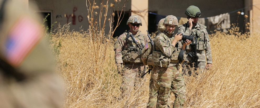 PHOTO: Turkish and American soldiers stand near a former YPG military point during a joint U.S.-Turkey patrol, near Tel Abyad, Syria, on Sept. 8, 2019.