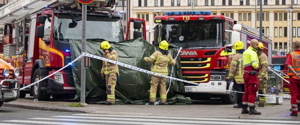 PHOTO: Rescue services attend the scene after a multiple stabbing incident on the Market Square in Turku, Finland, Aug. 18, 2017.