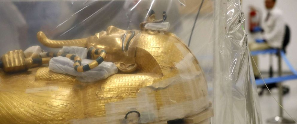 PHOTO: The gilded coffin of King Tutankhamun during a restoration process at the conservation center in the Grand Egyptian Museum of Cairo, Aug. 4, 2019.