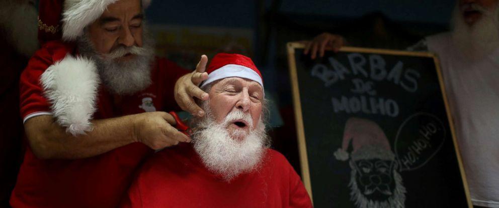 """PHOTO: Saymon Claus, a student of Brazils school of Santa Claus, has his beard cut during a ritual named """"Barbas de Molho"""" to mark the end of Christmas season in Rio de Janeiro, Dec. 26, 2018."""