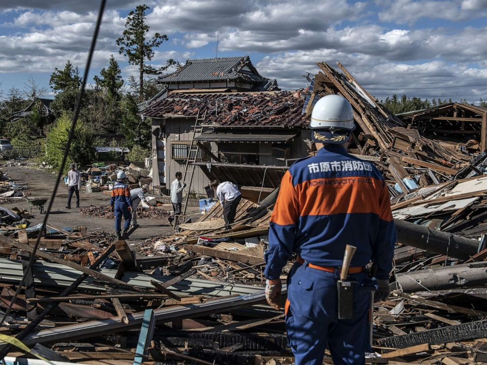 PHOTO: Search and rescue crews sort through the debris of a building destroyed by a tornado shortly before the arrival of Typhoon Hagibis, Oct. 13, 2019, in Chiba, Japan.