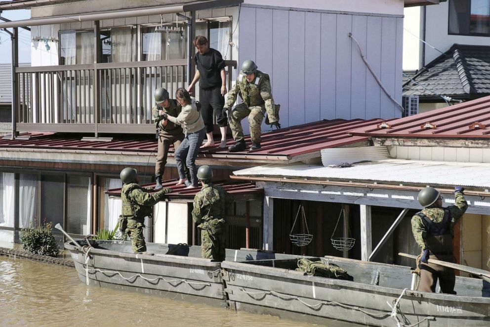 PHOTO: Local residents are rescued by Japapnese Defense-Force soldiers from a flooded area caused by Typhoon Hagibis in Kakuda, Miyagi prefecture, Japan, Oct. 13, 2019.