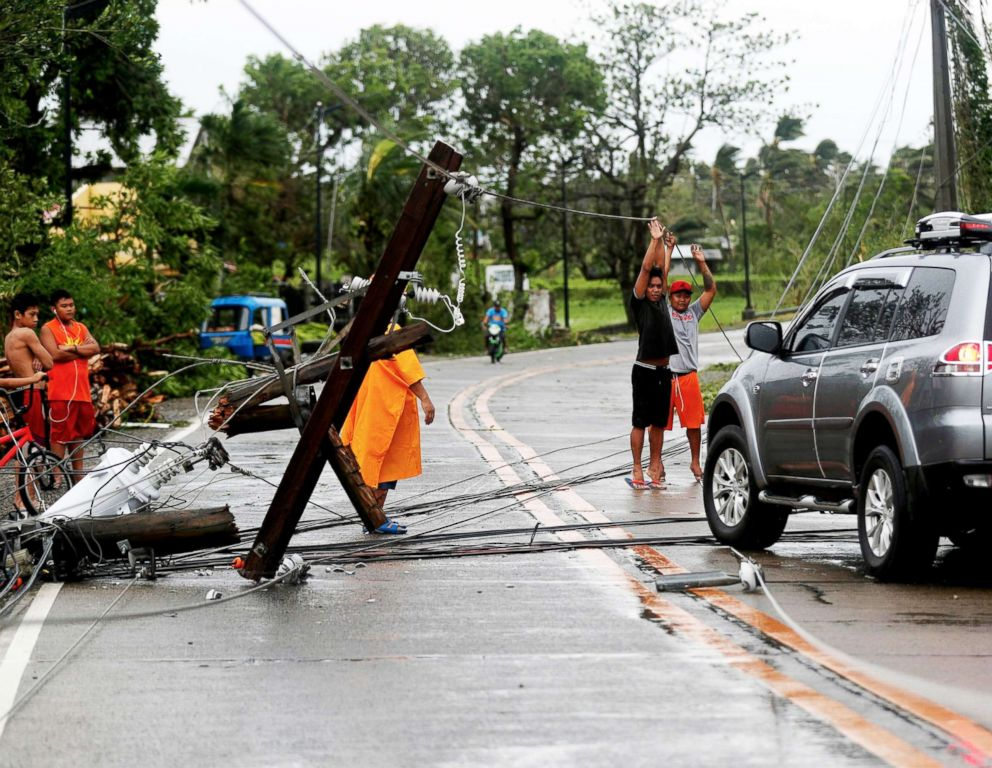 PHOTO: Filipino villagers lift electric wires in the typhoon-hit town of Lal-lo, Cagayan province, Philippines, Sept. 15, 2018.