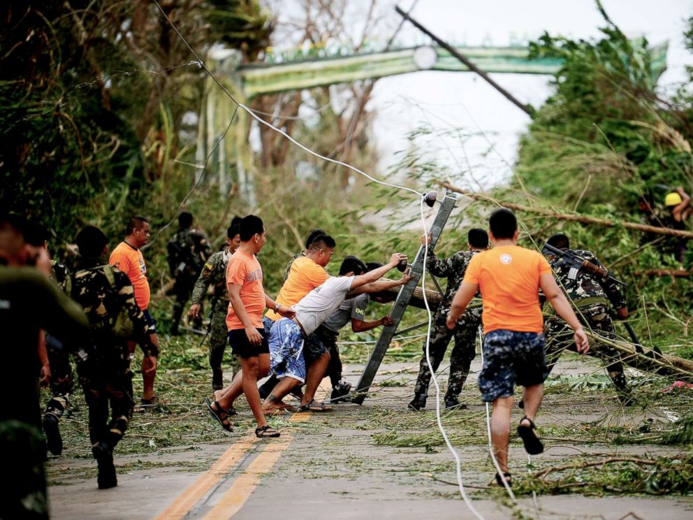 Search for landslide victims as Philippines typhoon toll rises