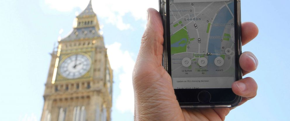 PHOTO: A photo illustration shows the Uber app on a mobile telephone, as it is held up for a posed photograph in central London, Sept. 22, 2017.