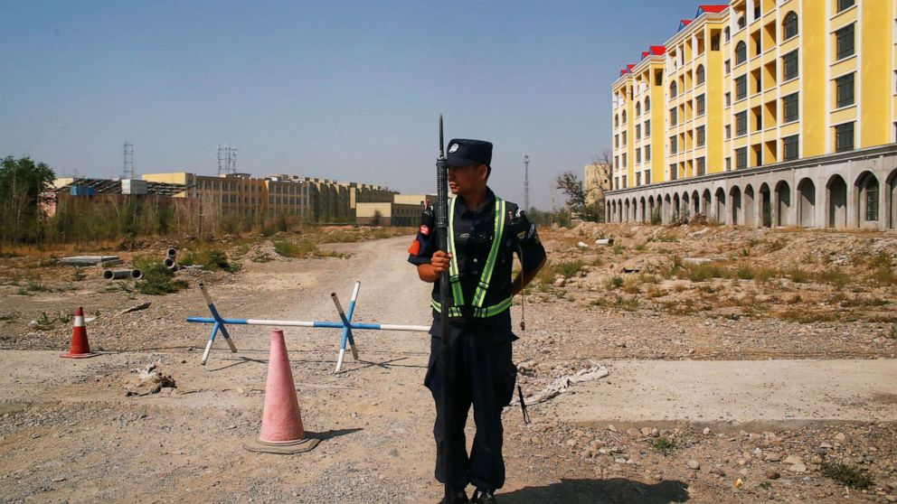 PHOTO: A Chinese police officer takes his position by the road near what is officially called a vocational education centre in Yining in Xinjiang Uighur Autonomous Region, China, Sept. 4, 2018.