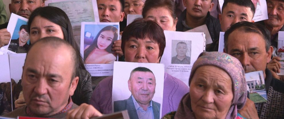 PHOTO: Families of the Uighur ethnic minority show pictures of their disappeared loved ones who have been sent to camps run by the Chinese government.