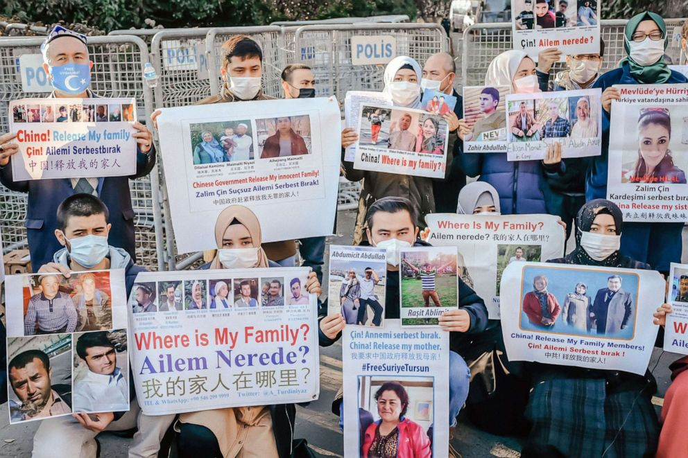 PHOTO: Members of the Muslim Uighur minority hold placards as they demonstrate in front of the Chinese consulate on Dec. 30, 2020, in Istanbul to ask for news of relatives and to express concern after China announced an extradition treaty with Turkey.