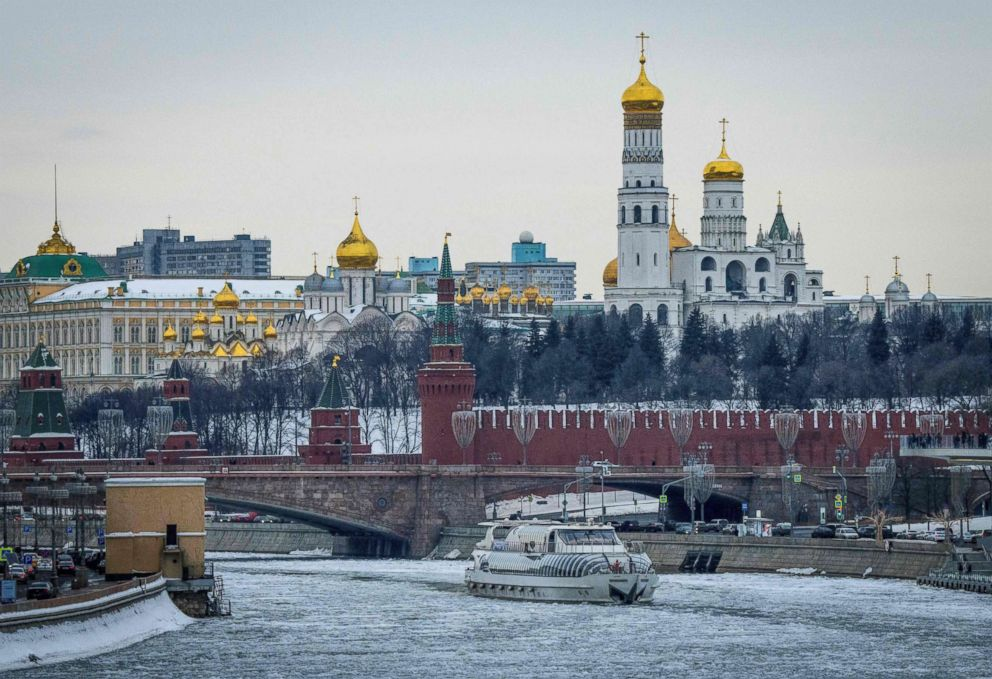 PHOTO: A tourist boat breaks through the frozen Moskva river outside the Kremlin in Moscow on March 13, 2018.