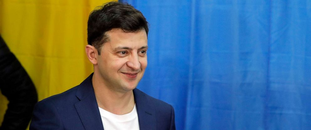PHOTO: Ukrainian comedian and presidential candidate Volodymyr Zelenskiy shows his ballot before casting his vote at a polling station, during the second round of presidential elections in Kiev, Ukraine, April 21, 2019.