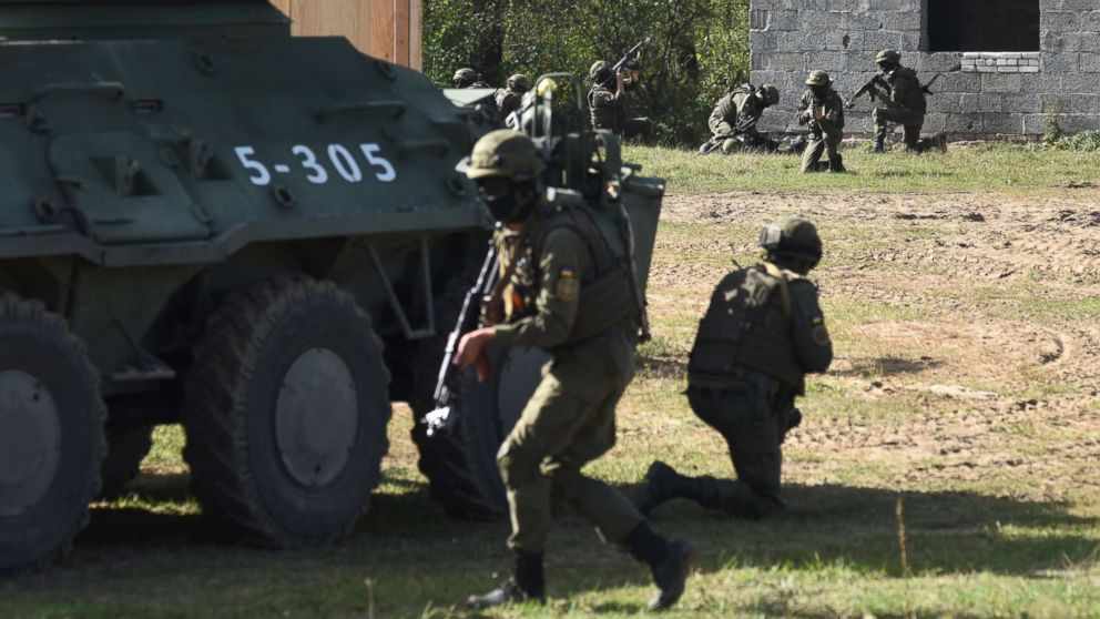 """Ukrainian soldiers take part in the """"Rapid Trident-2017"""" international military exercises at the Yavoriv shooting range not far from the western Ukrainian city of Lviv, Sept. 15, 2017. Rapid Trident-2017 involves approximately 1,800 personnel from 14 nations, including Bulgaria, Canada, Estonia, Italy, Georgia, Lithuania, Moldova, Norway, Poland, Romania, Turkey, Ukraine, the United Kingdom, and the United States."""