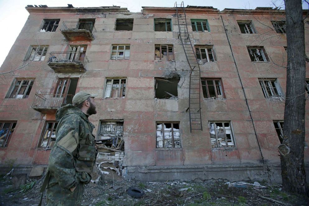 PHOTO:A Ukrainian serviceman walks past a building destroyed as a result of shelling by Russia-backed separatists in the small town of Zolote, April 20, 2019, on the eve of the second round of Presidential election in Ukraine.