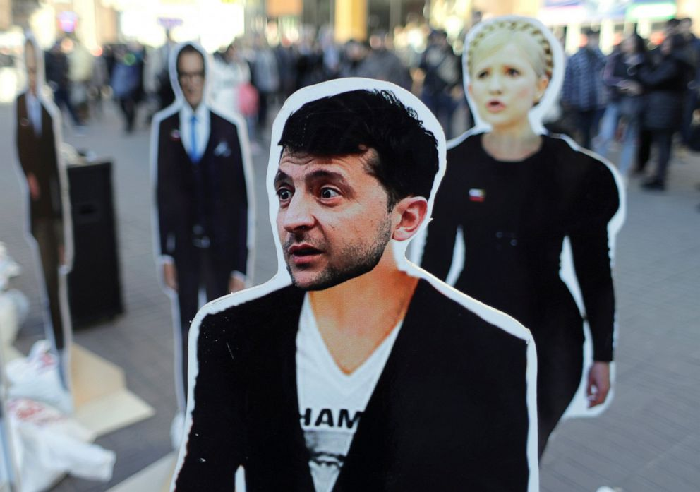 PHOTO: Cardboard images of presidential candidates Volodymyr Zelensky, foreground, and Yulia Tymoshenko, right, on display in central Kiev, Ukraine, Thursday, March 28, 2019. Ukraine will hold presidential elections on March 31.