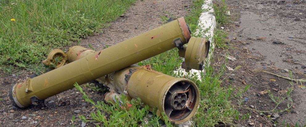 PHOTO: Tubes of portable anti-tank guided missiles lay near a parked ambulance in the village of Semyonovka, near the eastern Ukrainian city of Slavyansk, July 9, 2014, after fighting between Ukrainian forces and pro-Russian militants.