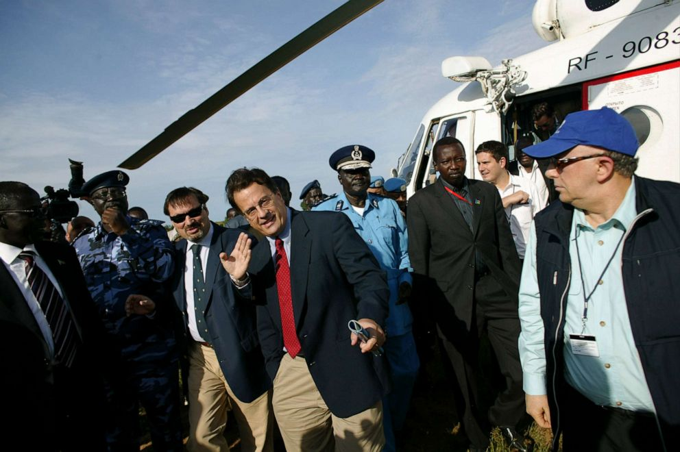 PHOTO: David Gressley, center in red tie, the southern head of the United Nations Mission in Sudan arrives at a police training academy in Rajaf, southern Sudan, Oct. 7, 2010.
