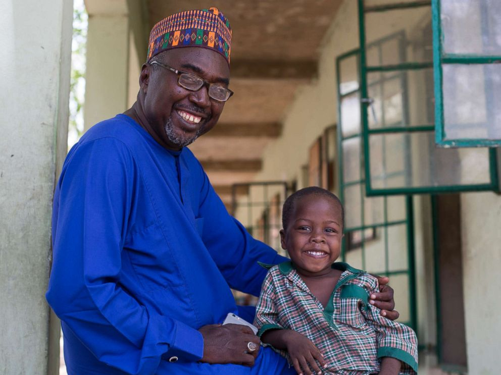 PHOTO: Zannah Mustapha and his son who is enrolled in a nursery class at the Future Prowess Islamic Foundation School in Maiduguri, Borno State, Nigeria, May 17, 2017.