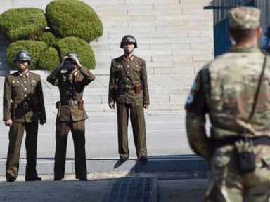 PHOTO: North Korean soldiers, left, look toward the South side while U.S. Defense Secretary Jim Mattis and South Korean Defense Minister Song Young-moo visit the truce village of Panmunjom on the border between North and South Korea, Oct. 27, 2017.