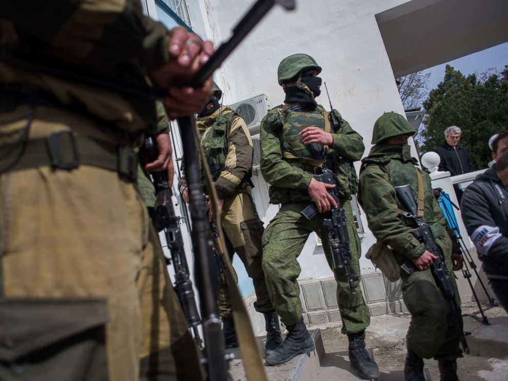 PHOTO: Soldiers in unmarked uniforms stand guard the entrance to the Ukrainian navy headquarters stormed by Crimean pro-Russian self-defense forces in Sevastopol, Crimea, March 19, 2014.