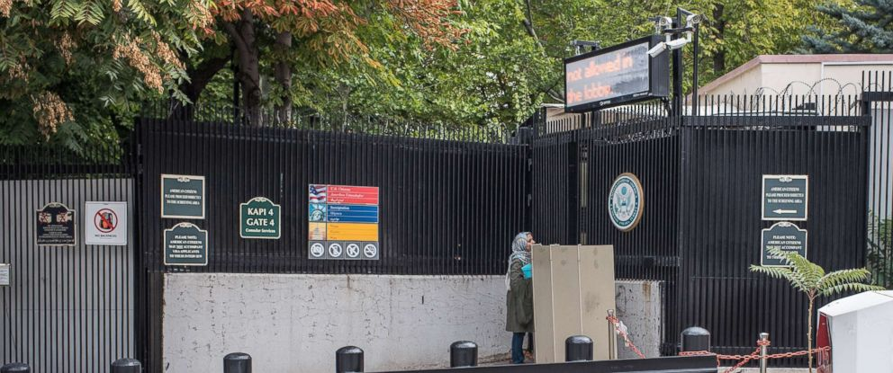 PHOTO: A woman stands at the closed entrance of the United States Embassy in Ankara, Turkey, Oct. 9, 2017. American visa services were halted at US missions in Turkey following the detention of US consulate personnel in Istanbul.