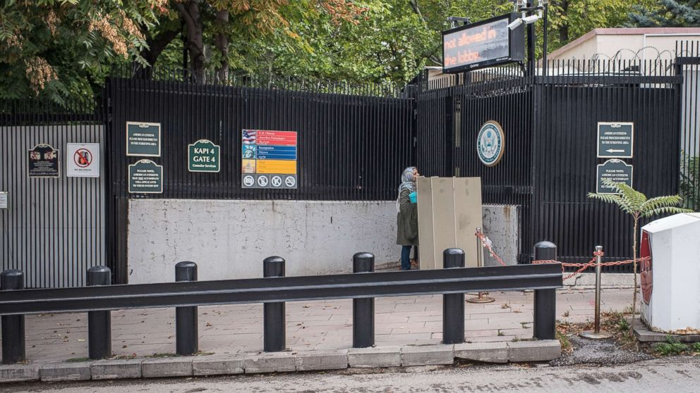 A woman stands at the closed entrance of the United States Embassy in Ankara, Turkey, Oct. 9, 2017. American visa services were halted at US missions in Turkey following the detention of US consulate personnel in Istanbul, a move that sparked a diplomatic backlash between both countries.