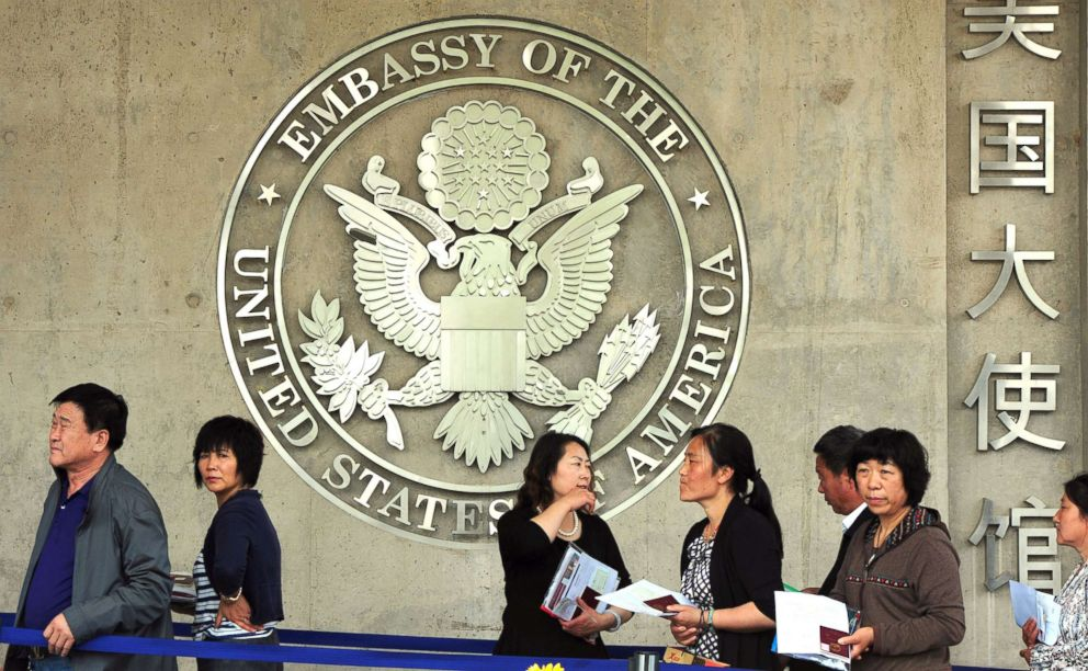 PHOTO: Chinese citizens wait to submit their visa applications at the US Embassy where blind rights activist Chen Guangcheng is believed to be hiding, in Beijing on May 2, 2012.