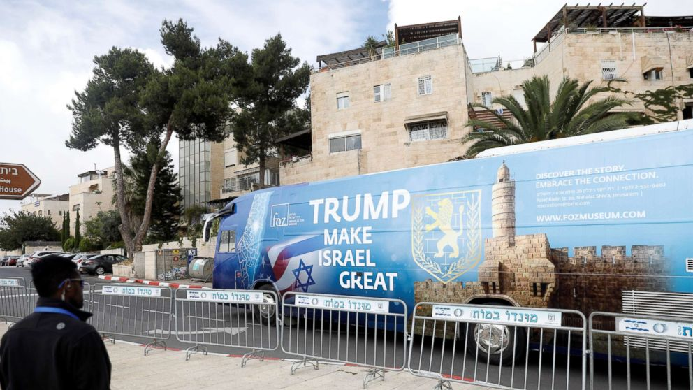 A bus decorated with Israeli and U.S. flags and a message welcoming the move of the U.S. embassy to Jerusalem is seen near the location of the new U.S. embassy in Jerusalem, May 13, 2018.