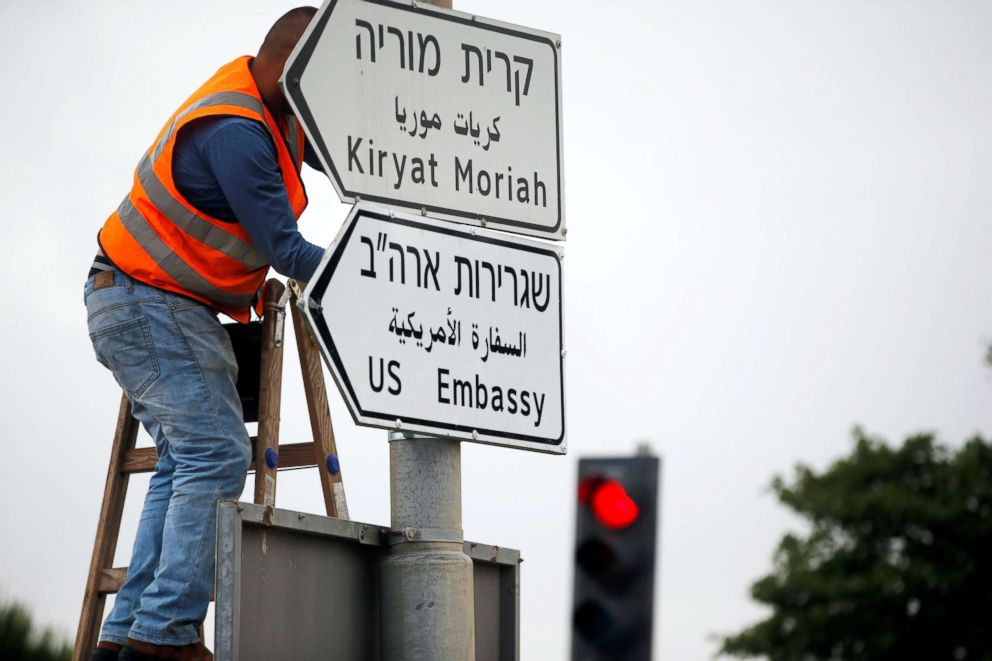 PHOTO: A worker hangs a road sign directing to the U.S. embassy, in the area of the U.S. consulate in Jerusalem, May 7, 2018.