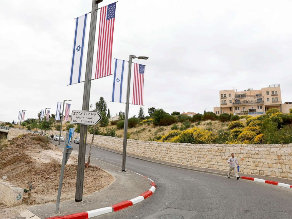PHOTO: A new road sign and flags are placed at the road leading to the U.S. consulate in the Jewish neighborhood of Arnona on the East-West Jerusalem line in Jerusalem, May 8, 2018.
