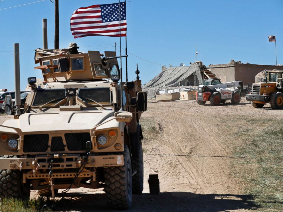 PHOTO: A U.S. soldier sits on an armored vehicle behind a sand barrier at a newly installed position near the front line between the U.S-backed Syrian Manbij Military Council and the Turkish-backed fighters, in Manbij, north Syria.