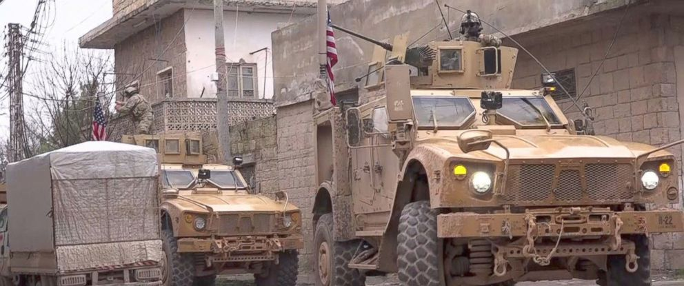 PHOTO: An image grab taken from a video obtained by AFPTV on January 16, 2019, shows US armoured vehicles at the scene of a suicide attack in the northern Syrian town of Manbij.