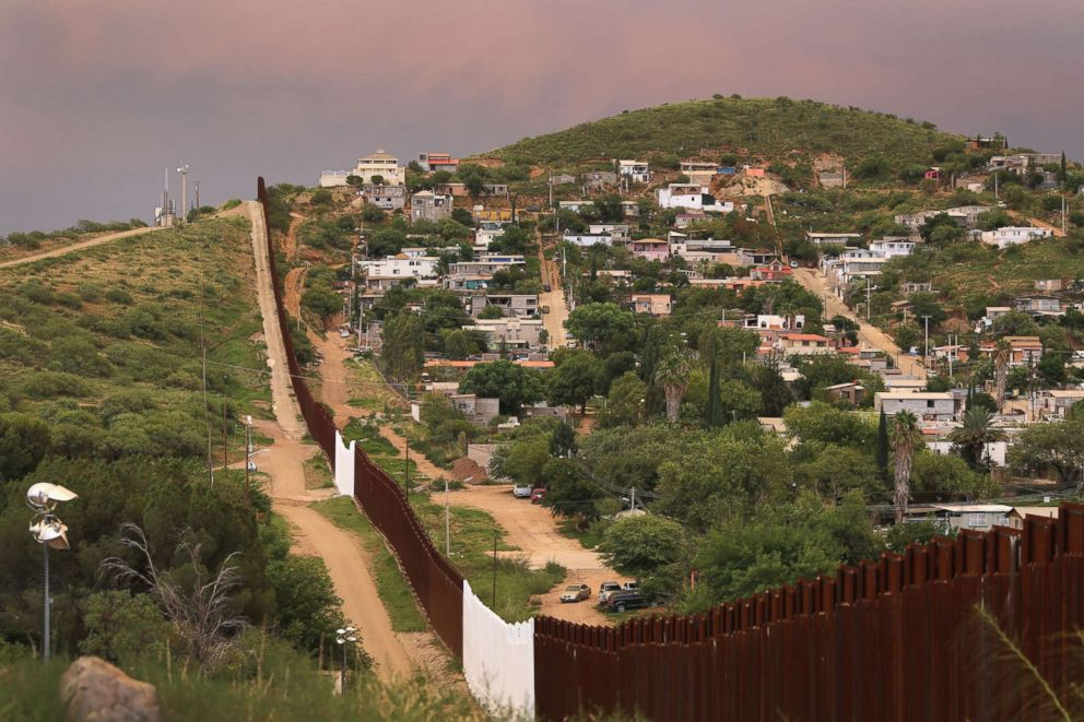 PHOTO: The U.S.-Mexico border fence is seen at sunset, July 22, 2018, in Nogales, Ariz.