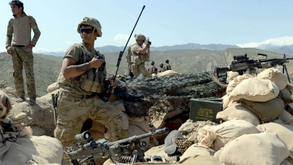 In this photograph taken on April 11, 2017, US soldiers take up positions during an ongoing an operation against Islamic State (IS) militants in the Achin district of Afghanistan's Nangarhar province.