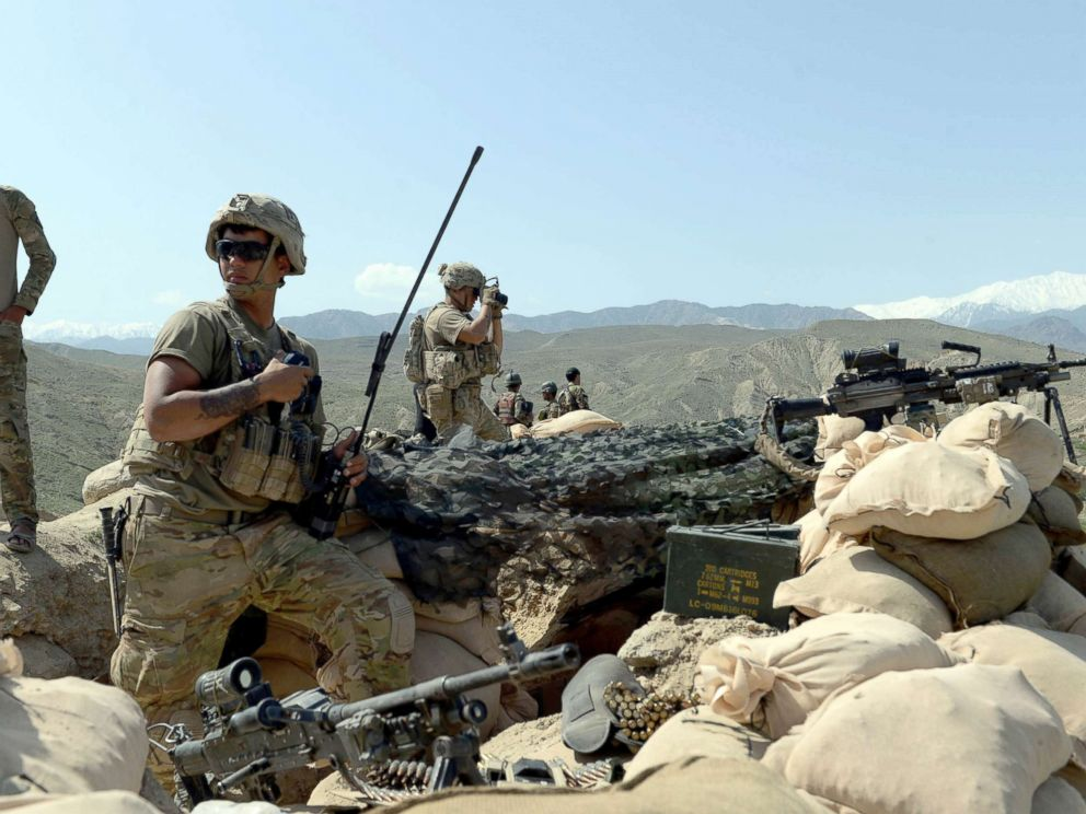 PHOTO: In this photograph taken on April 11, 2017, US soldiers take up positions during an ongoing an operation against Islamic State (IS) militants in the Achin district of Afghanistans Nangarhar province.