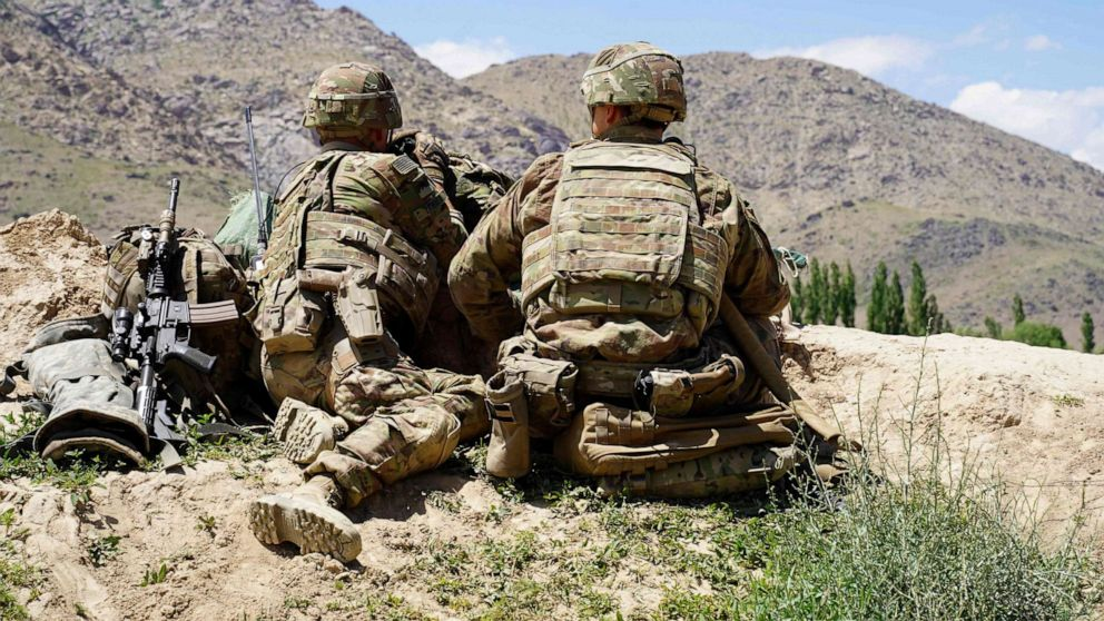 PHOTO: In this June 6, 2020, file photo, US soldiers look out over hillsides at the Afghan National Army (ANA) checkpoint in Nerkh district of Wardak province, Afghanistan.