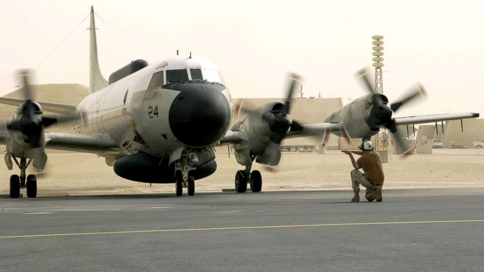 A U.S. Navy EP-3E Aries aircraft is directed by ground crew after a flight from Bahrain, Sept. 25, 2016.