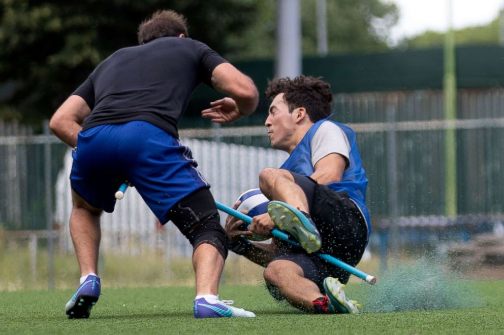 PHOTO: US Quidditch players Harry Greenhouse, left, and Martin Bermudez Jr., practice in Florence, Italy, June 26, 2018.  Harry Potter comes to Italy as Americans compete in Quidditch World Cup us quidditch team 02 ht jef 180626 hpEmbed 3x2 992