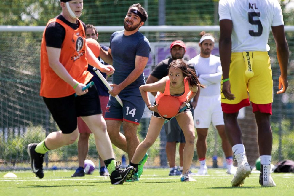 PHOTO: US Quidditch beaters Max Havlin, in blue shirt, and Lulu Xu, in orange, hold bludgers (the orange dodgeballs) during practice in Florence, Italy, June 26, 2018.  Harry Potter comes to Italy as Americans compete in Quidditch World Cup us quidditch team 03 ht jef 180626 hpEmbed 3x2 992