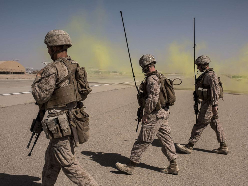 PHOTO: Members of the U.S. Marine Corp Task Force South West walk across a runway after marking a location for an airdrop of cargo on Sept. 10, 2017 at Camp Shorab in Helmand Province, Afghanistan.