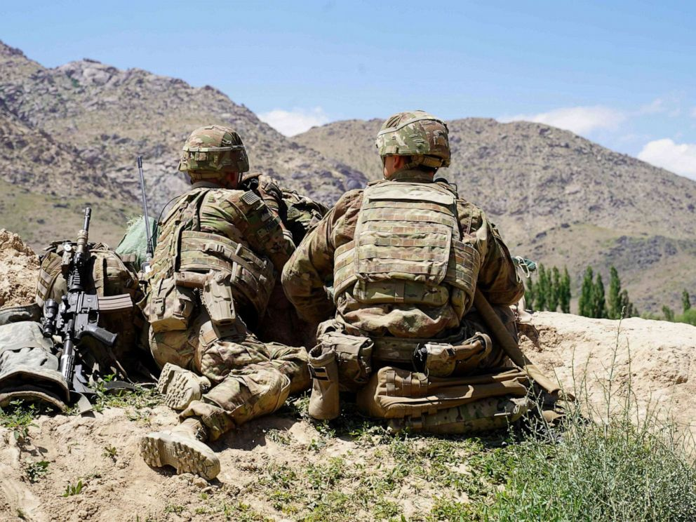 PHOTO: In this photo taken on June 6, 2019, U.S. soldiers look out over hillsides during a visit of the commander of U.S. and NATO forces in Afghanistan Gen. Scott Miller at the Afghan National Army (ANA) checkpoint in Nerkh district of Wardak province.