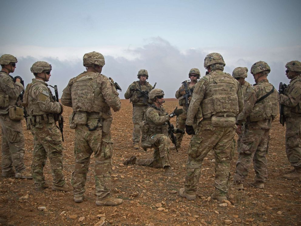 PHOTO: U.S. Soldiers gather for a brief during a combined joint patrol rehearsal in Manbij, Syria, Nov. 7, 2018.