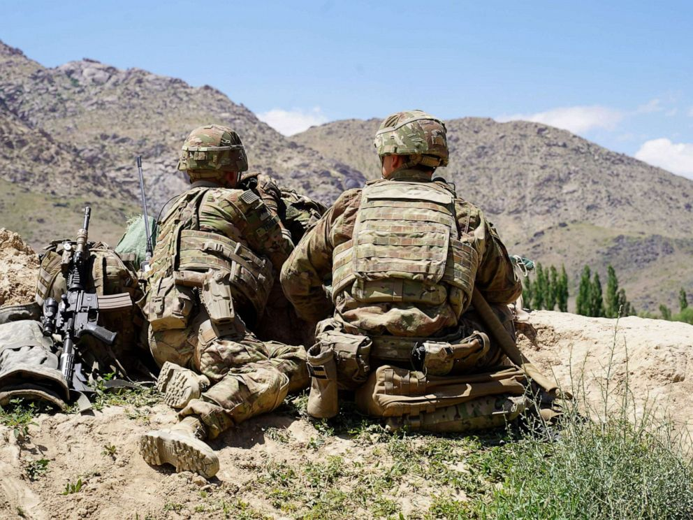 PHOTO: In this photo taken on June 6, 2019, US soldiers look out over hillsides during a visit of the commander of US and NATO forces in Afghanistan General Scott Miller at the Afghan National Army (ANA) checkpoint in Nerkh district of Wardak province.