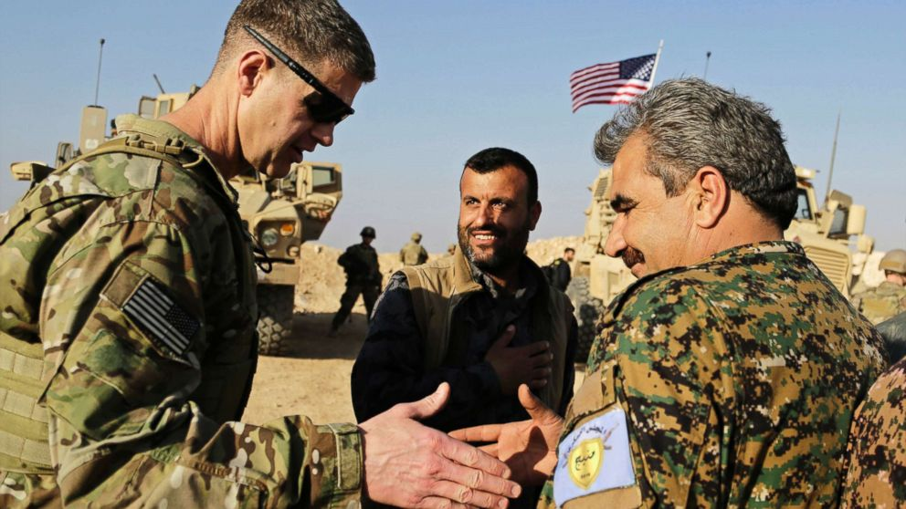 U.S. Army Maj. Gen. Jamie Jarrard (L), thanks Manbij Military Council commander Muhammed Abu Adeel during a visit to a small outpost near the town of Manbij, northern Syria, Feb. 7, 2018. Lt. Gen. Paul E. Funk, the top U.S. general in the coalition fighting the Islamic State group pledged American troops would remain in the town despite Ankara's demands for a U.S. pullout.