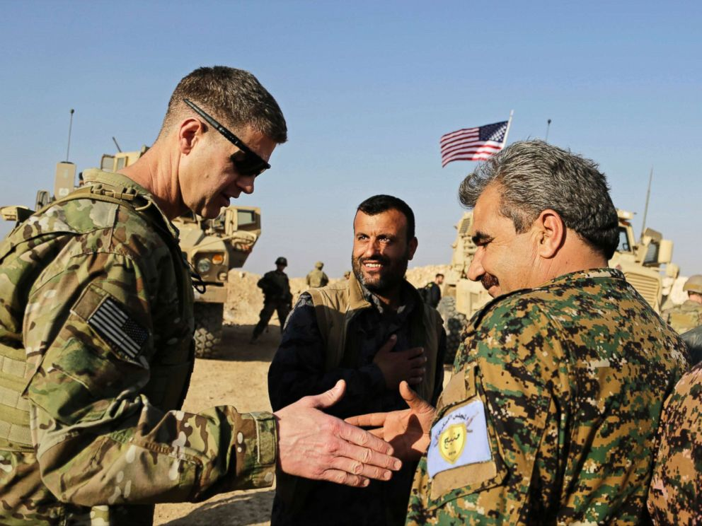 PHOTO: U.S. Army Maj. Gen. Jamie Jarrard (L), thanks Manbij Military Council commander Muhammed Abu Adeel during a visit to a small outpost near the town of Manbij, northern Syria, Feb. 7, 2018.